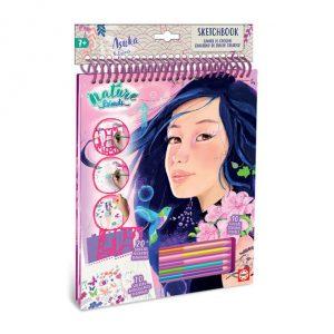 Caderno de actividades e desenho para + 7 anos com lápis coloridos e moldes para desenhar roupas.